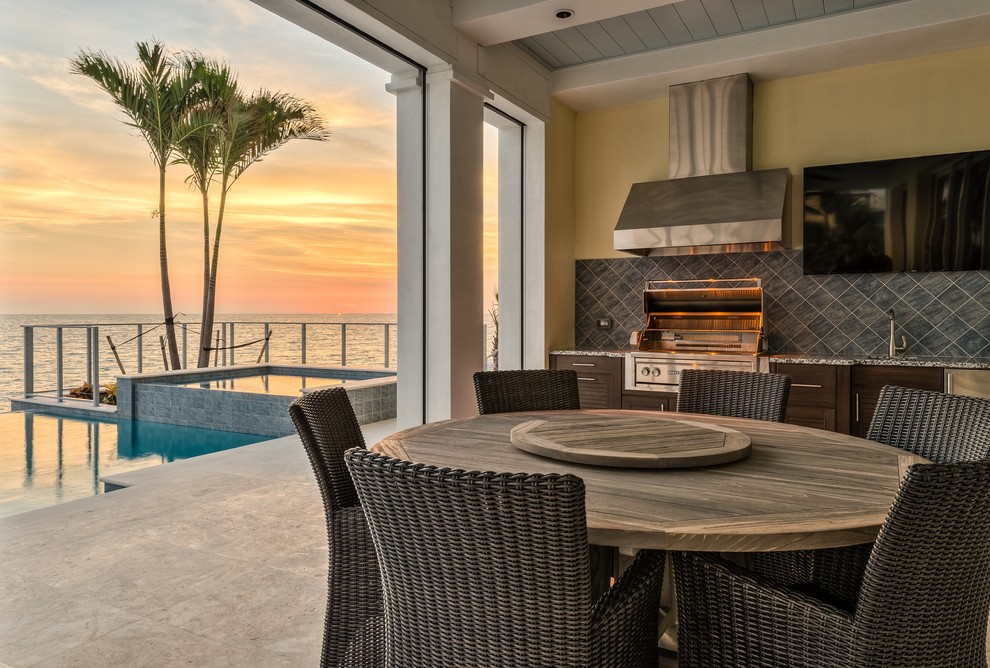 Beach Style Porch Design With Outdoor Kitchen
