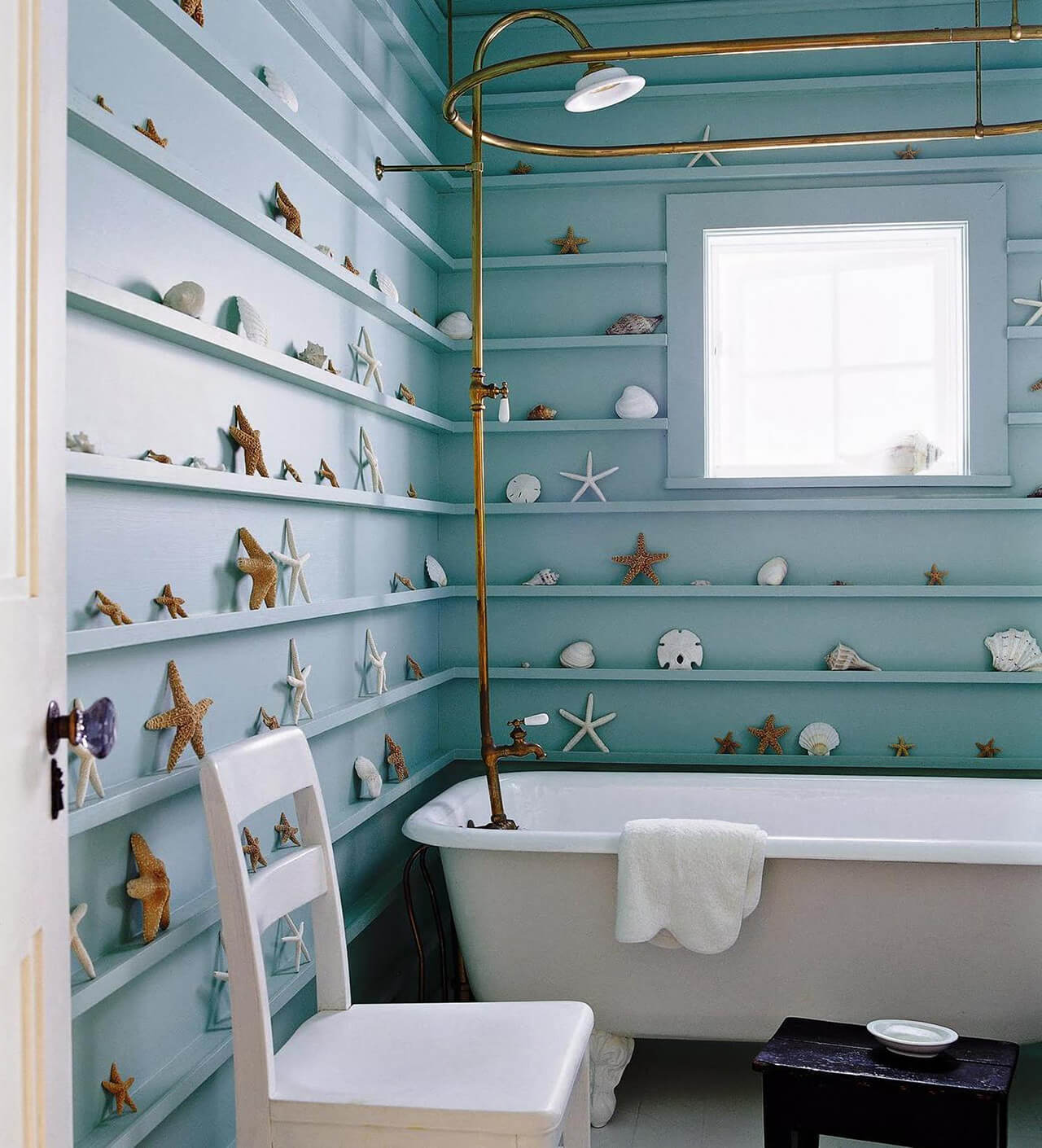 Small Beach Style Bathroom With Monochromatic Ledge Shelves