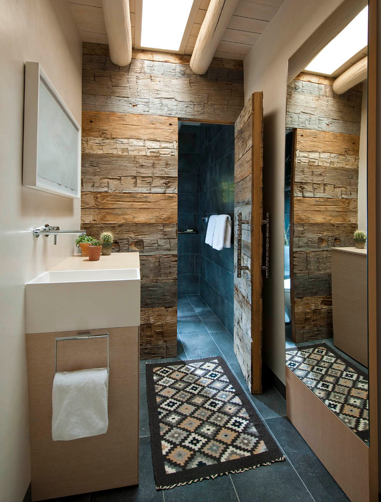 Southwestern Bathroom With Alcove Shower and Black Tile