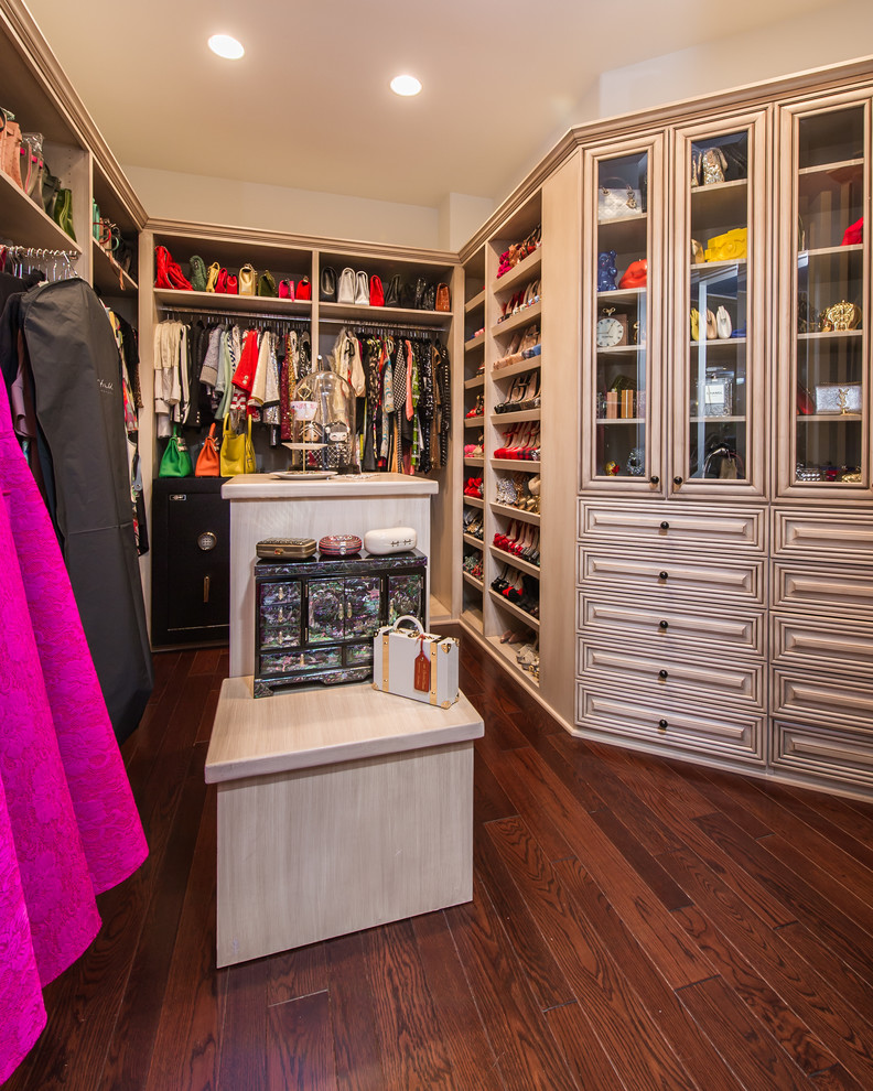 Mediterranean Women's Dark Wood Floor Walk-in Closet