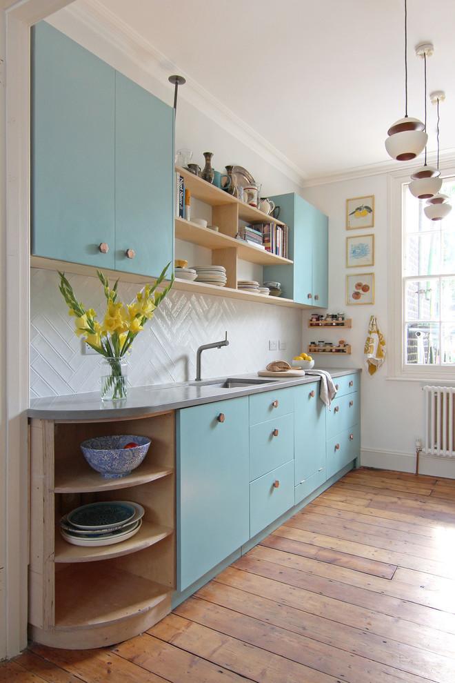 Scandinavian Kitchen With Copper Handles and Concrete Worktop