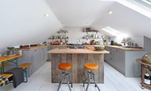 Small Kitchen With IReclaimed Wood Base And Concrete Top
