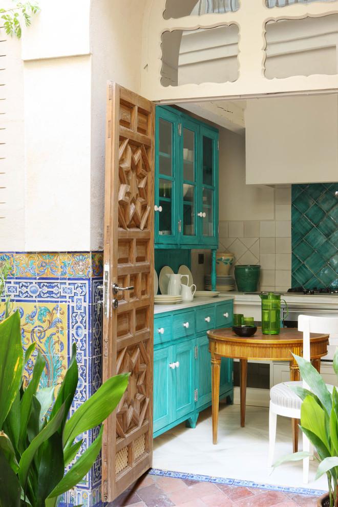Small Mediterranean U-shaped Kitchen Dwellingdecor