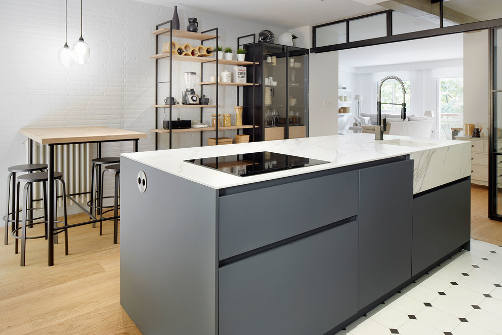 Scandinavian Galley Kitchen With gray cabinets and an island dwellingdecor
