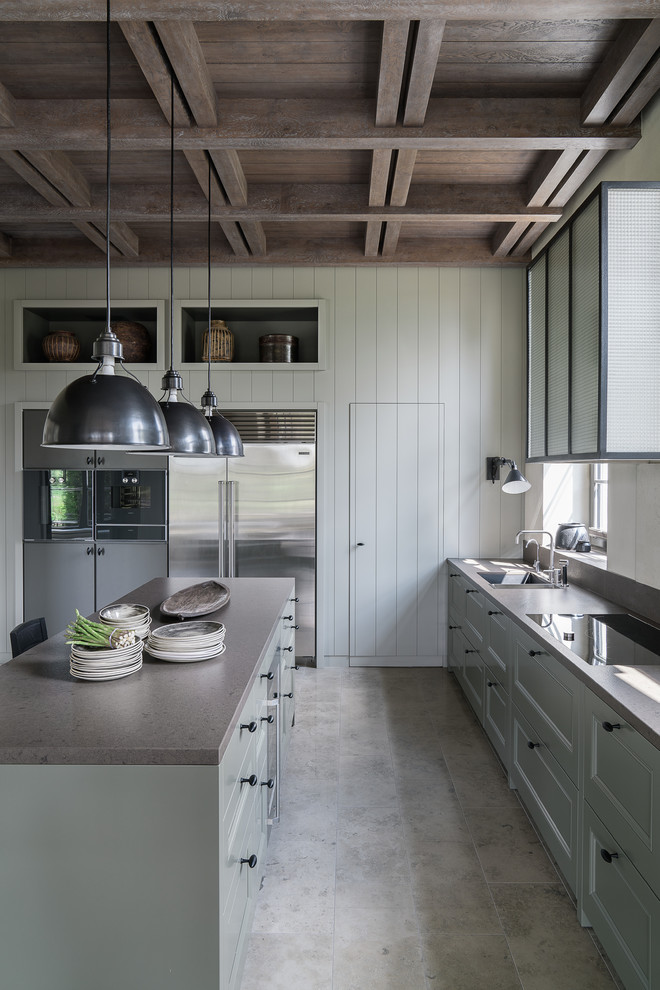 farmhouse kitchen with an island & gray cabinets and stainless steel appliances dwellingdecor