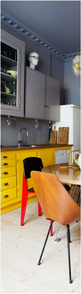 Kitchen With Yellow cabinet against gray walls and ceilings