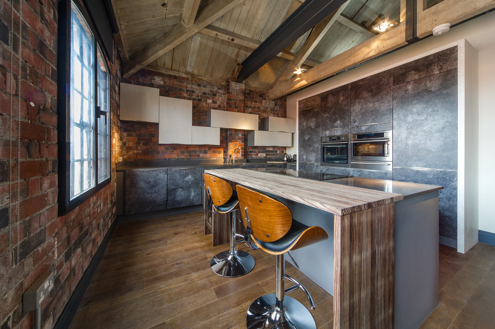Small Urban U-shaped Industrial Kitchen