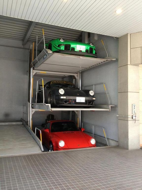 Contemporary Garage With Brick Floors & High Ceiling Dwellingdecor