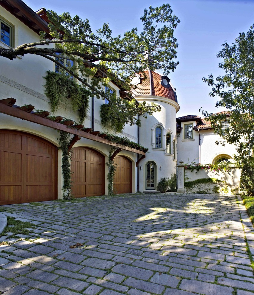 Large Tuscan Attached Three-car Garage Dwellingdecor