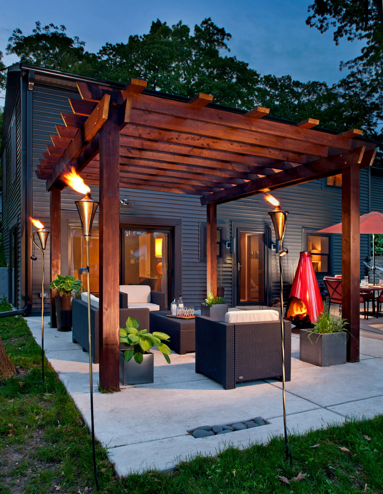 Contemporary Patio Design With Pergola dwellingdecor