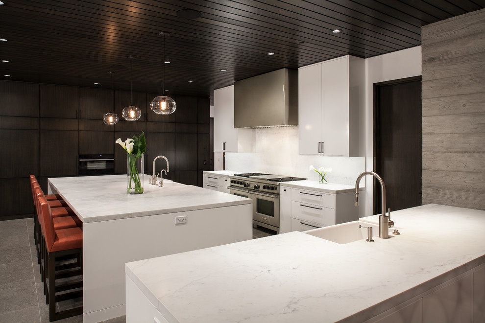 Large Trendy U-shaped Kitchen With Flat-panel Cabinets
