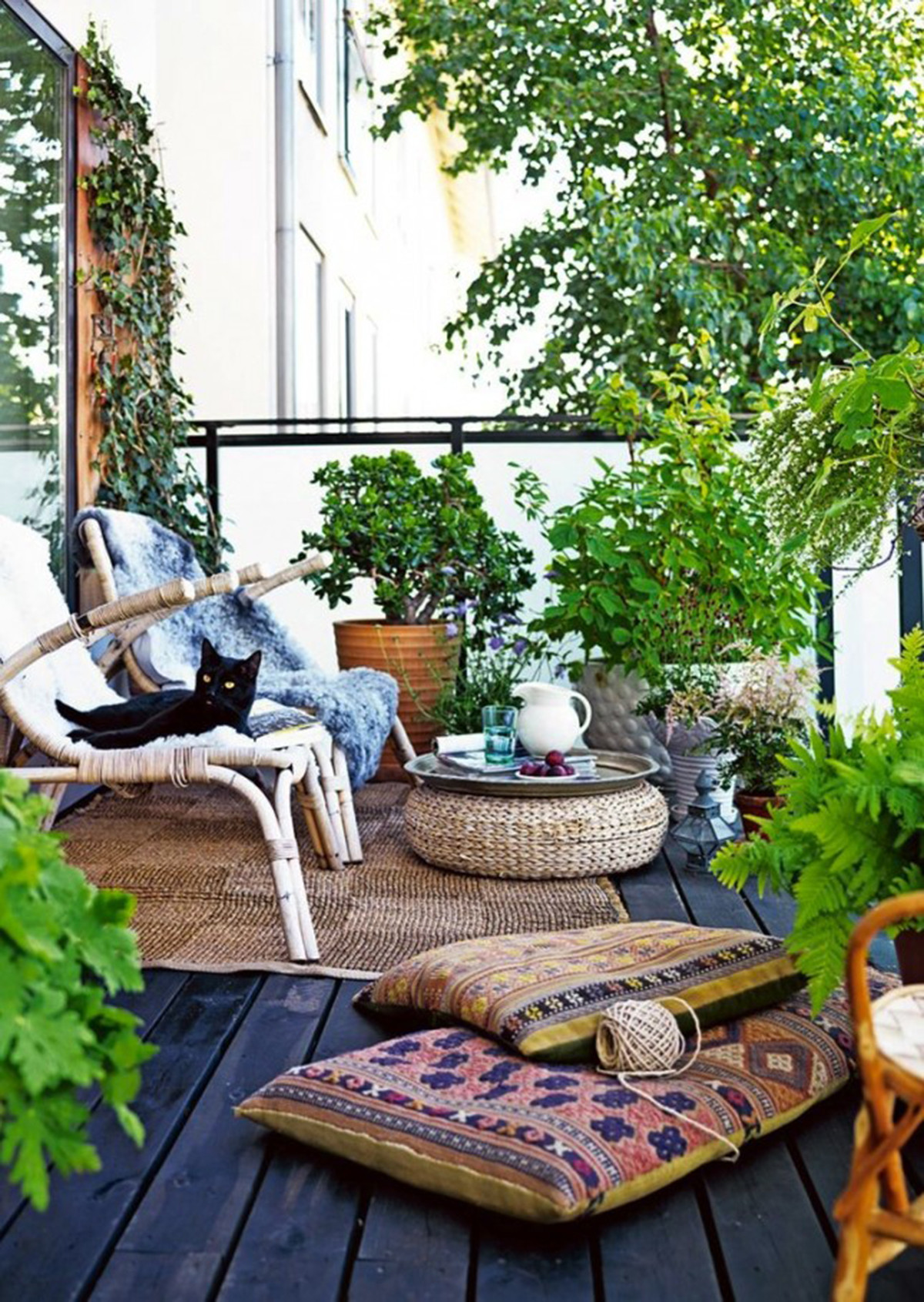 Small Balcony Garden With Rattan Rug on Wooden Deck Dwellingdecor
