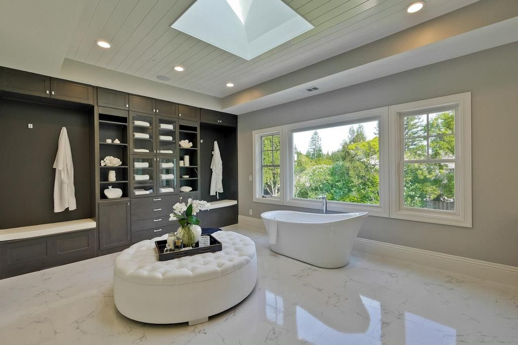 Master bathroom with handheld shower head and a freestanding tub