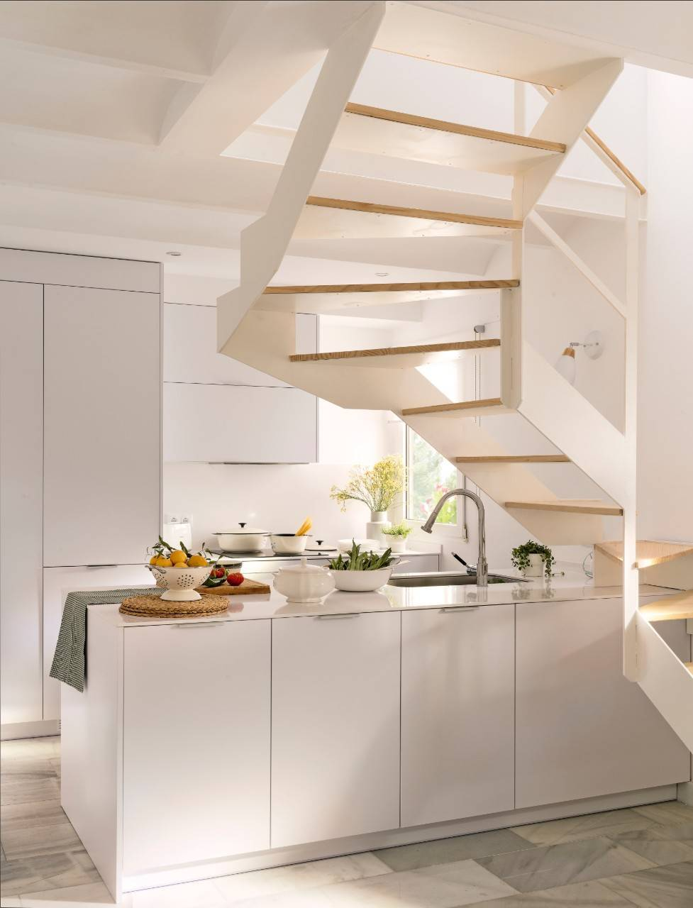 A MINI KITCHEN UNDER THE STAIRS