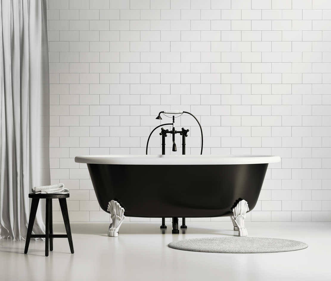 Black and white classic bathtub on brick wall