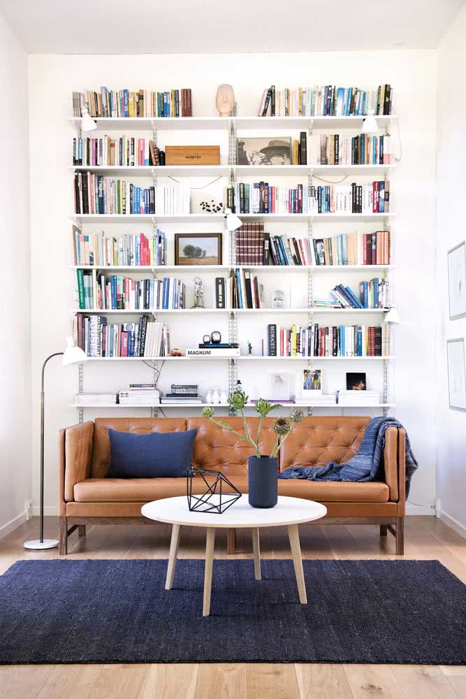 A sofa in symmetrical harmony with the bookcase.