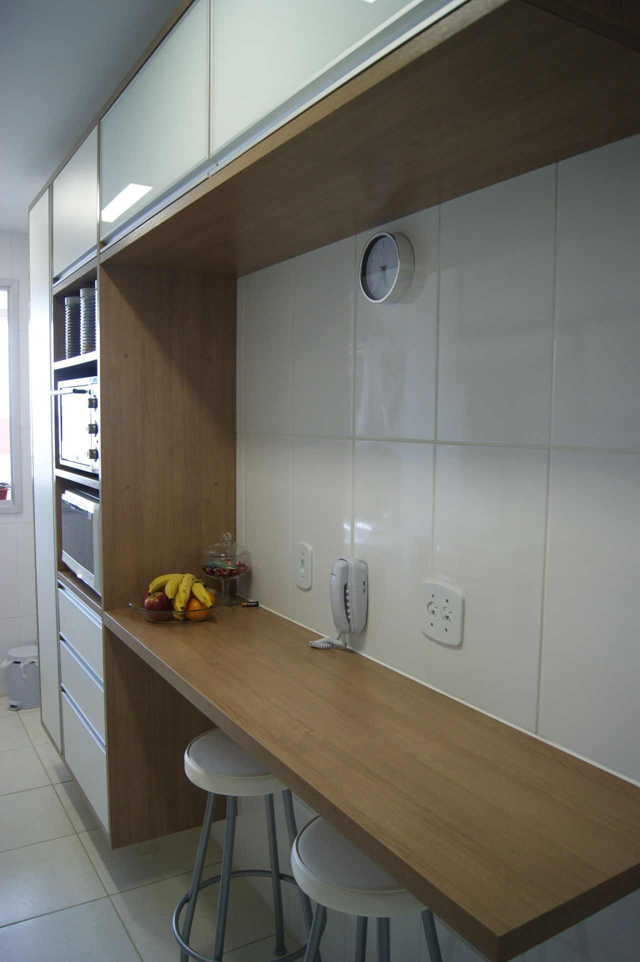 Light wood countertops and white stools