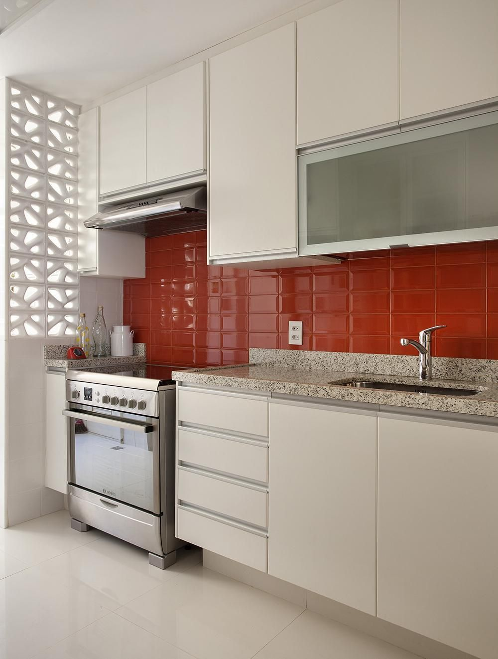 Red cladding and white custom furniture