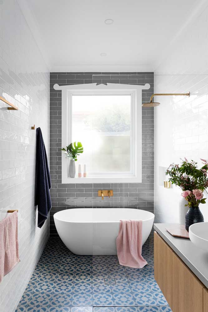 This small bathroom has the bathtub installed next to the window.