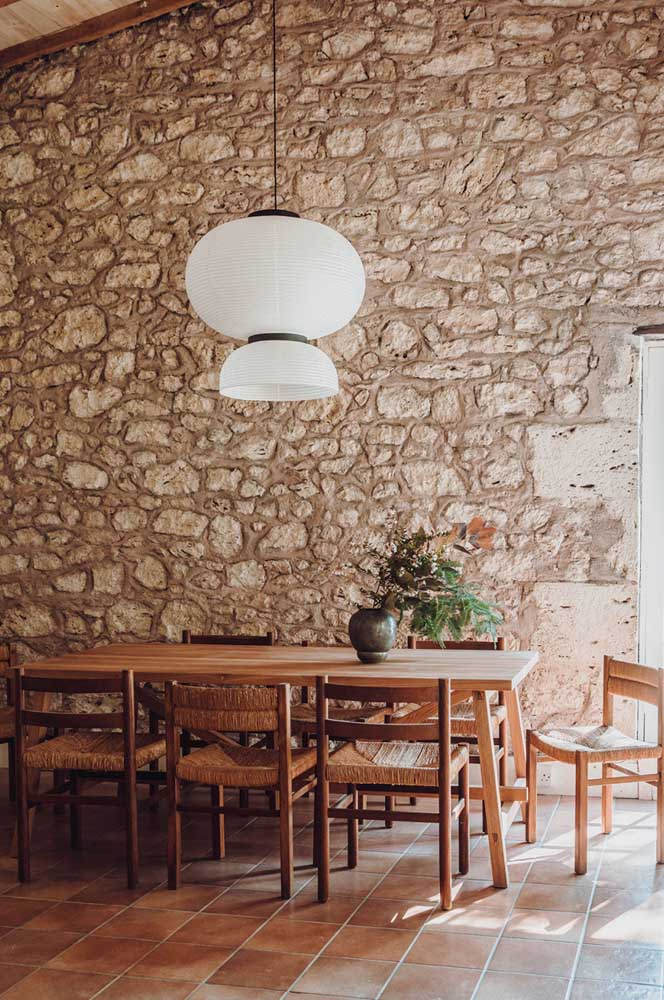 02. Dining room with rustic decor contrasted by the white lamp.