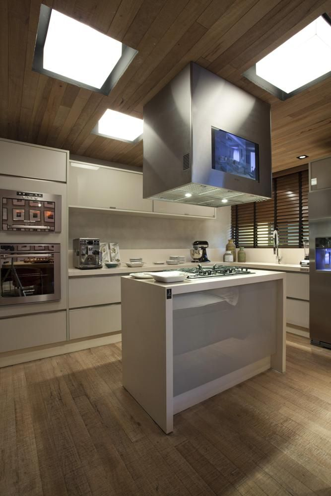 06. Island design with hood for hood and built-in TV