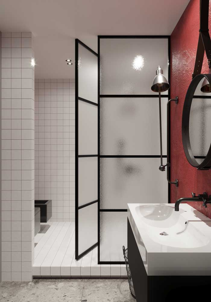 06. Modern decorated bathroom with glass shower and red wall.