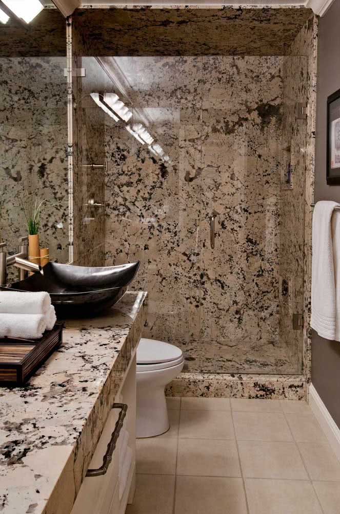 10 - In this bathroom, the same granite used for countertops covers the area of the box.