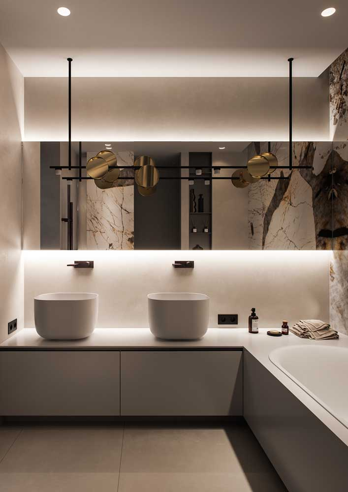 11. Mirrors and lighting tailored to enhance the decorated bathroom.