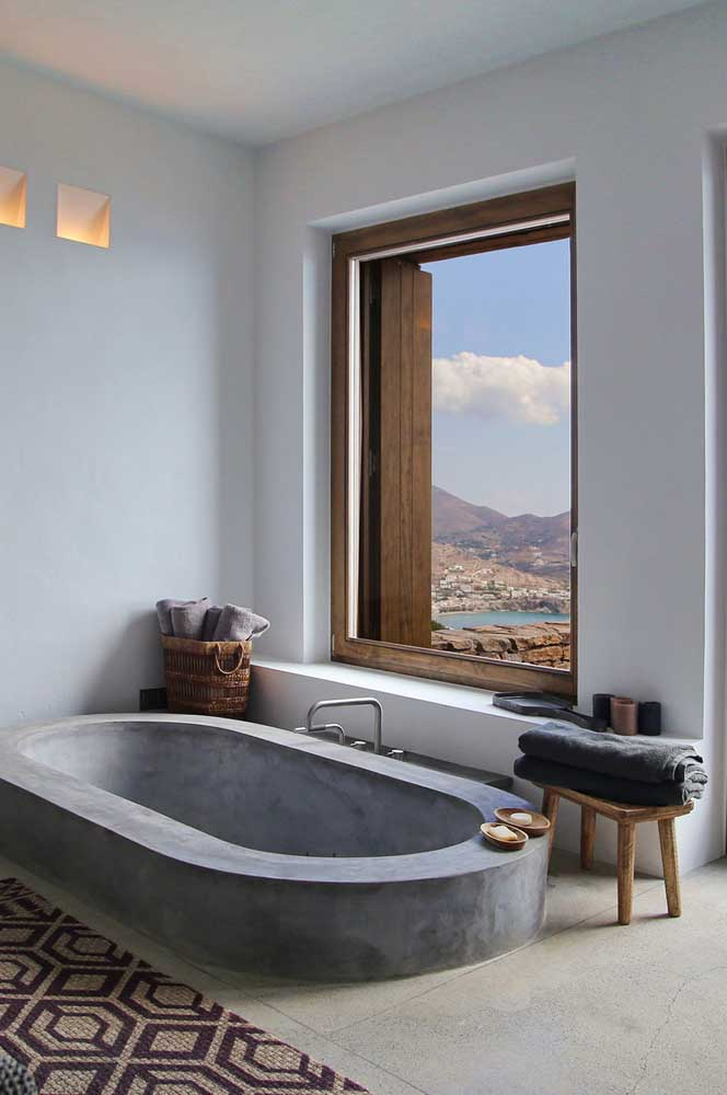 13. Rustic and modern bathroom that mixes the use of wood and burnt cement.