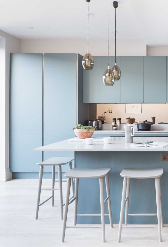 14. The soft shade of blue marks this other small kitchen with custom cabinets and a large counter.