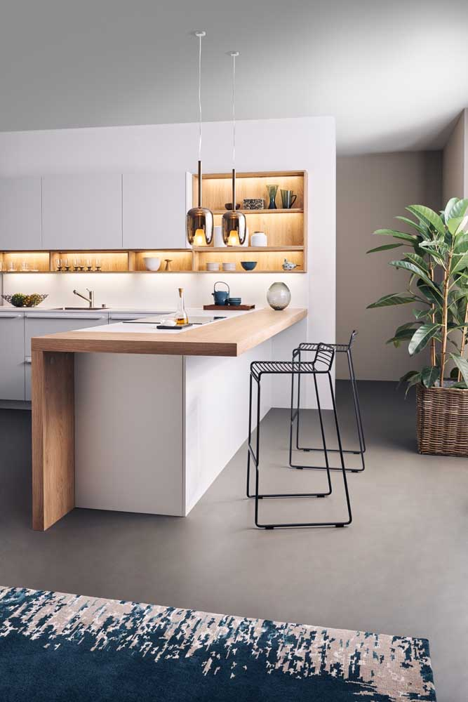 15. Small modern American kitchen decorated with niches and LED lighting.