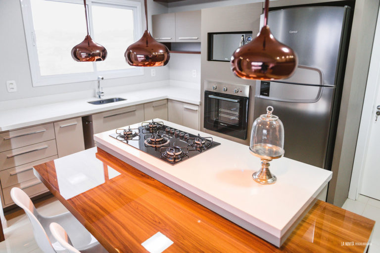 16. Central island with cooktop and copper chandeliers