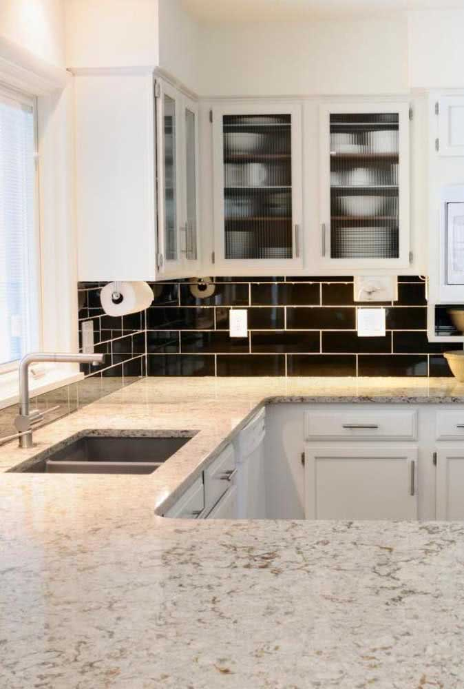 17 - Kitchen in black and white has what? A white granite countertop of course!