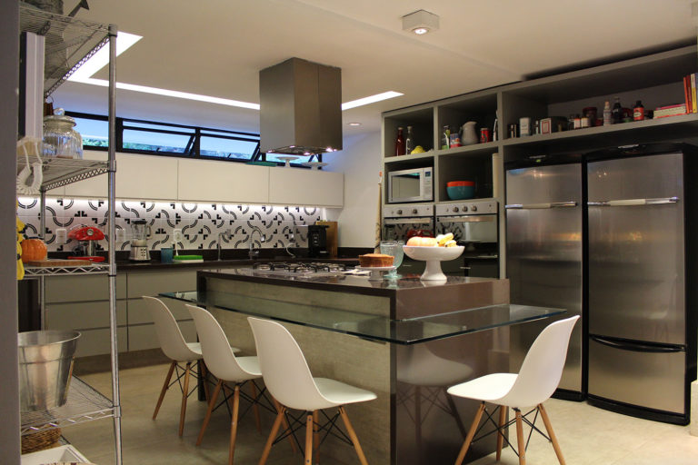 17. Kitchen with center island and glass countertop