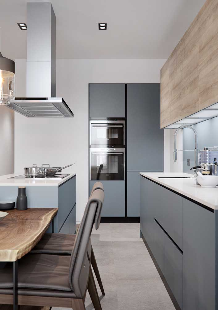 17. Small American kitchen with island;highlight to the wooden dining table that was part of the project.