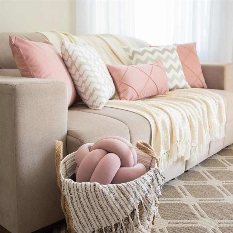 18 - Clean room decorated with plain and patterned pillows