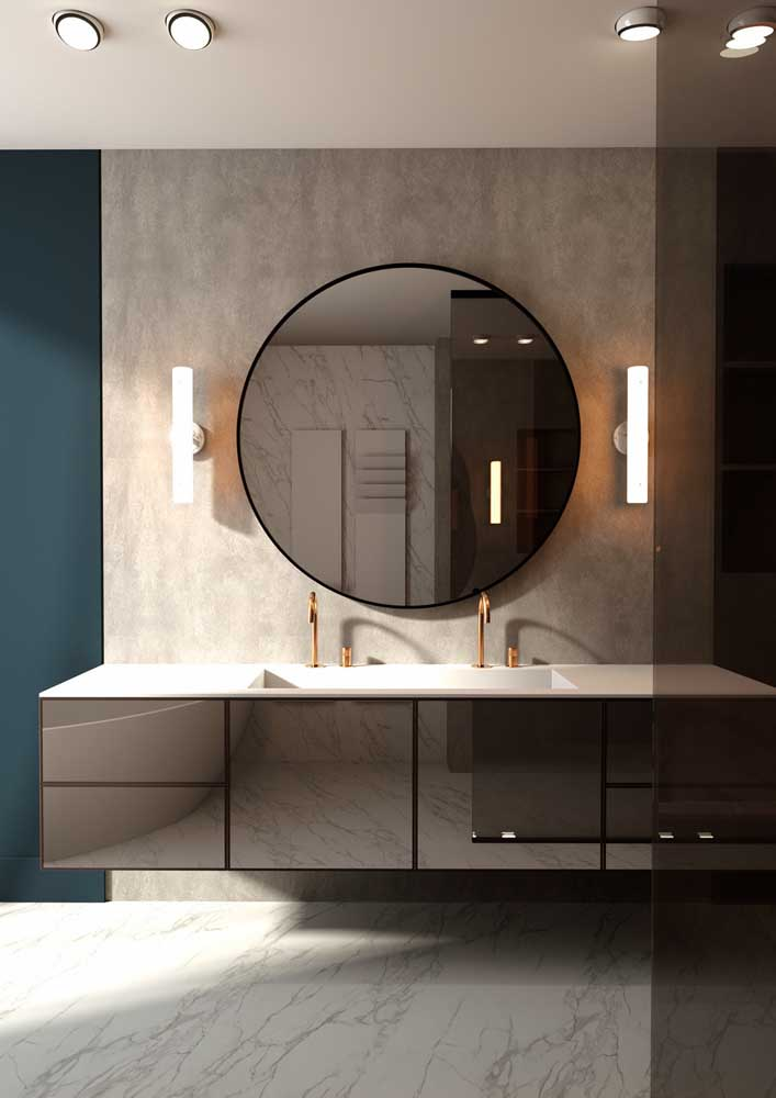 18. Modern decorated bathroom has neutral colors and slightly shiny surfaces.