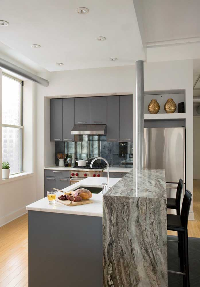 18. Simple small American kitchen also has space for fine finishes like marble.