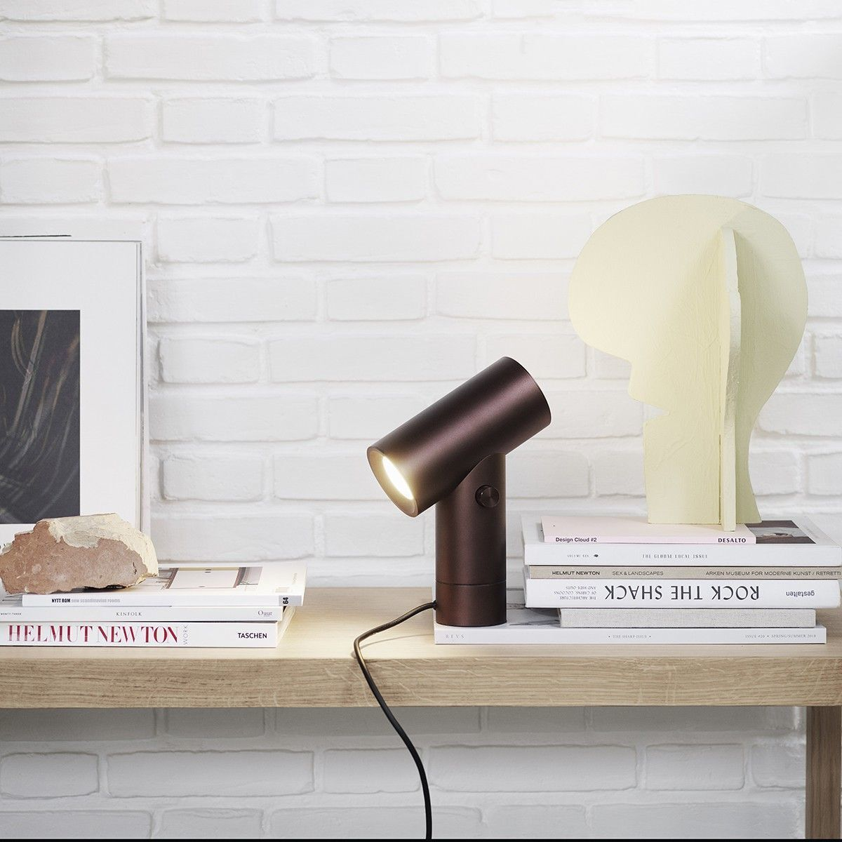 19 -A small contemporary lamp looking like a spot at Muuto