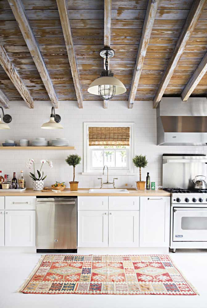 20. Rustic white kitchen with emphasis on the use of patina on the ceiling.