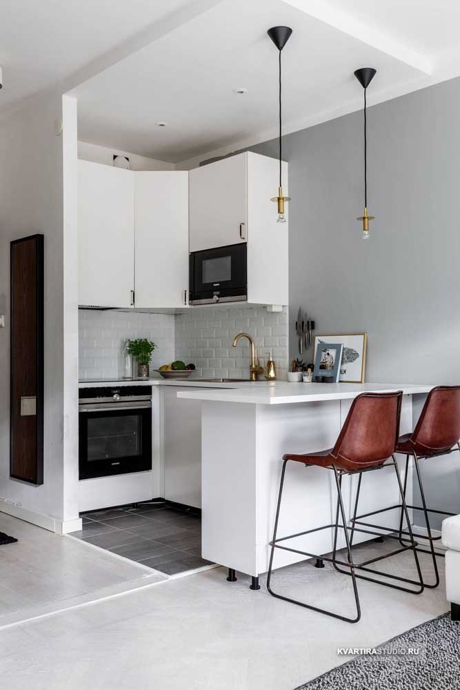 26. Simple small kitchen with custom-made furniture;it's the details that make the difference in this project.