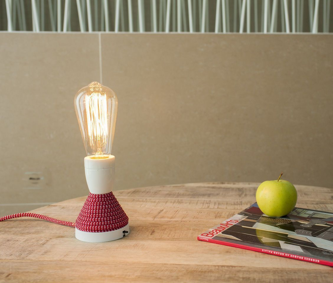 29 -Unusual, a bulb lamp signed Gross Domestic Product
