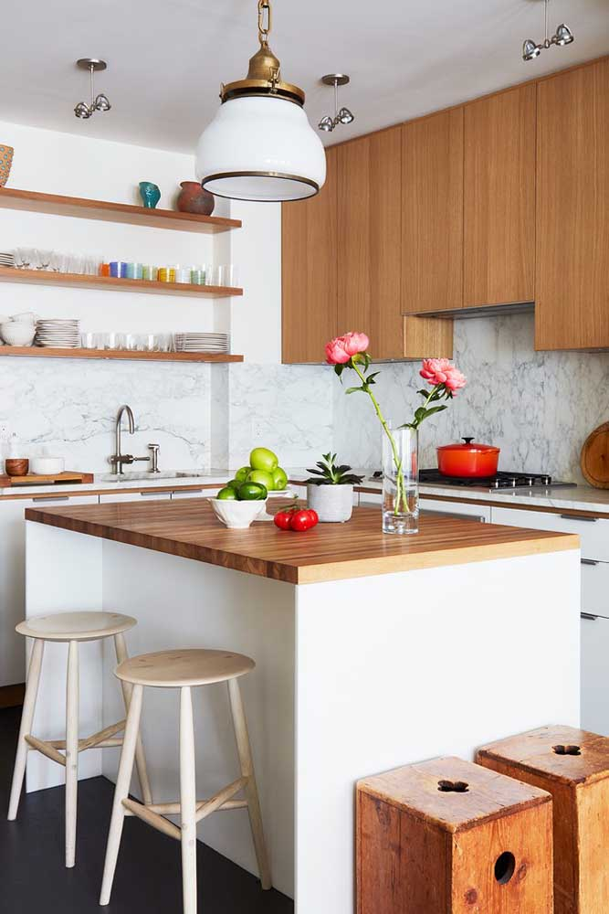 29. Small kitchen with island;the shelves help to make the environment cleaner