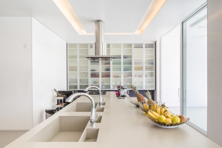 30. Kitchen with center island and double carved sinks