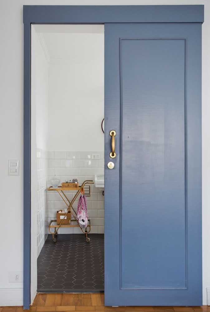 32 - A blue sliding door with golden handle for you to fall in love.