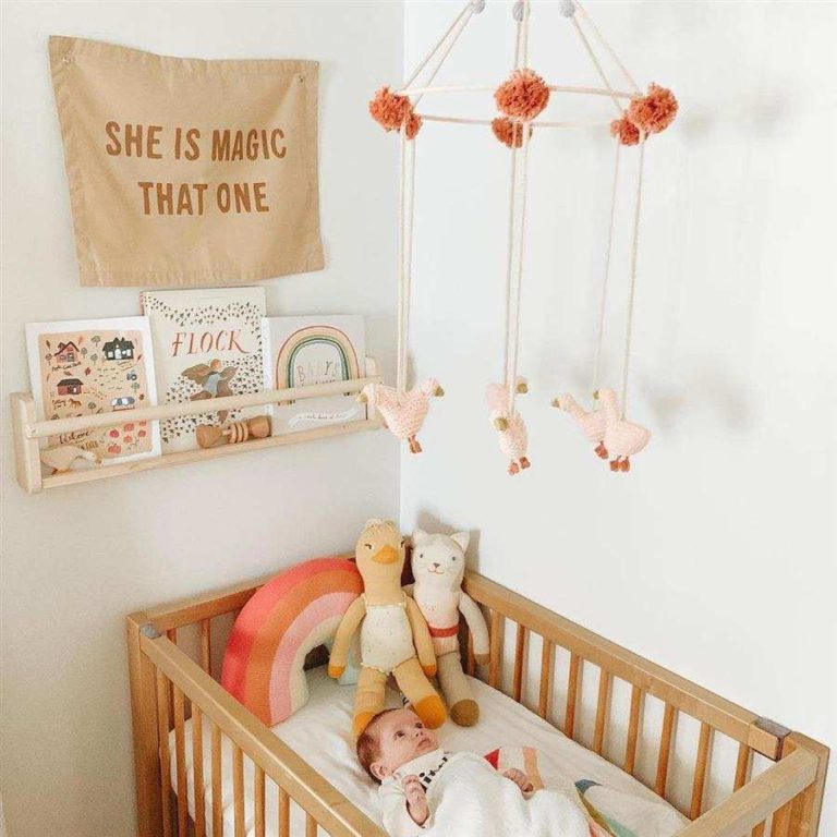33 - Baby room decorated with mobile and book shelf
