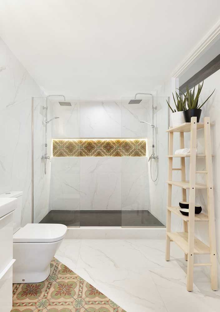 34. White bathroom with just a few color details.