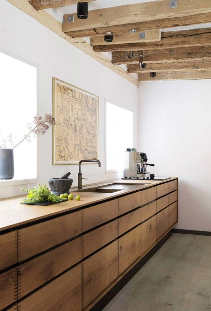 36. Wooden beams matching the cabinet.