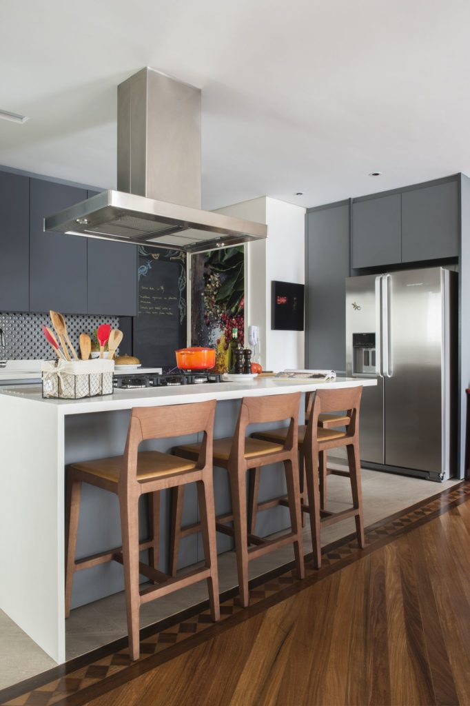 37. Central island with white stone and large stainless steel hood