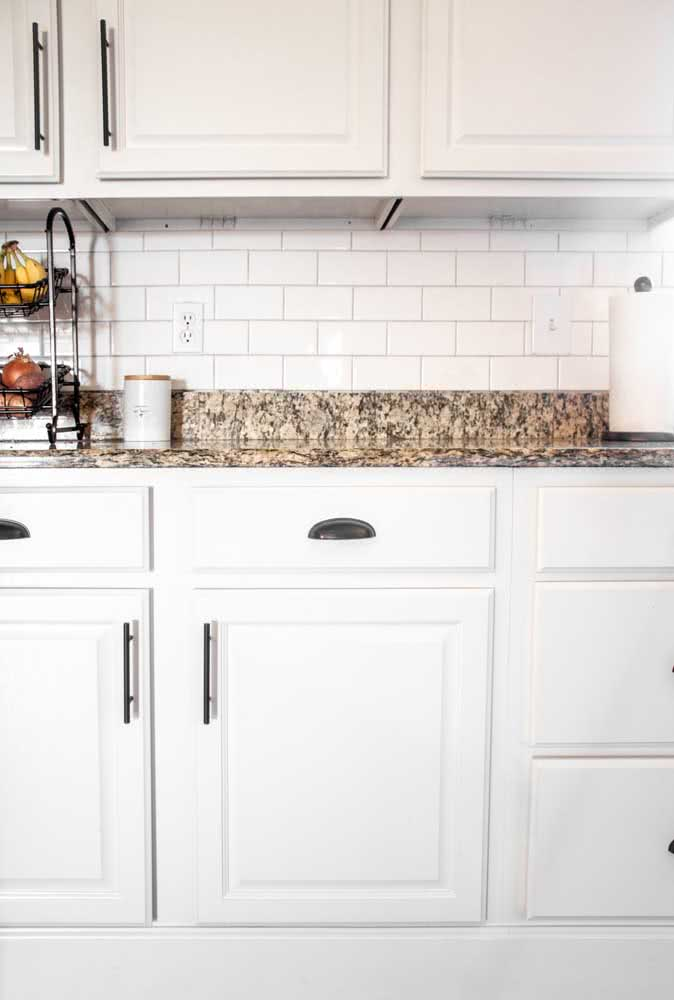 39 - The white kitchen gained color with the yellow granite countertop.